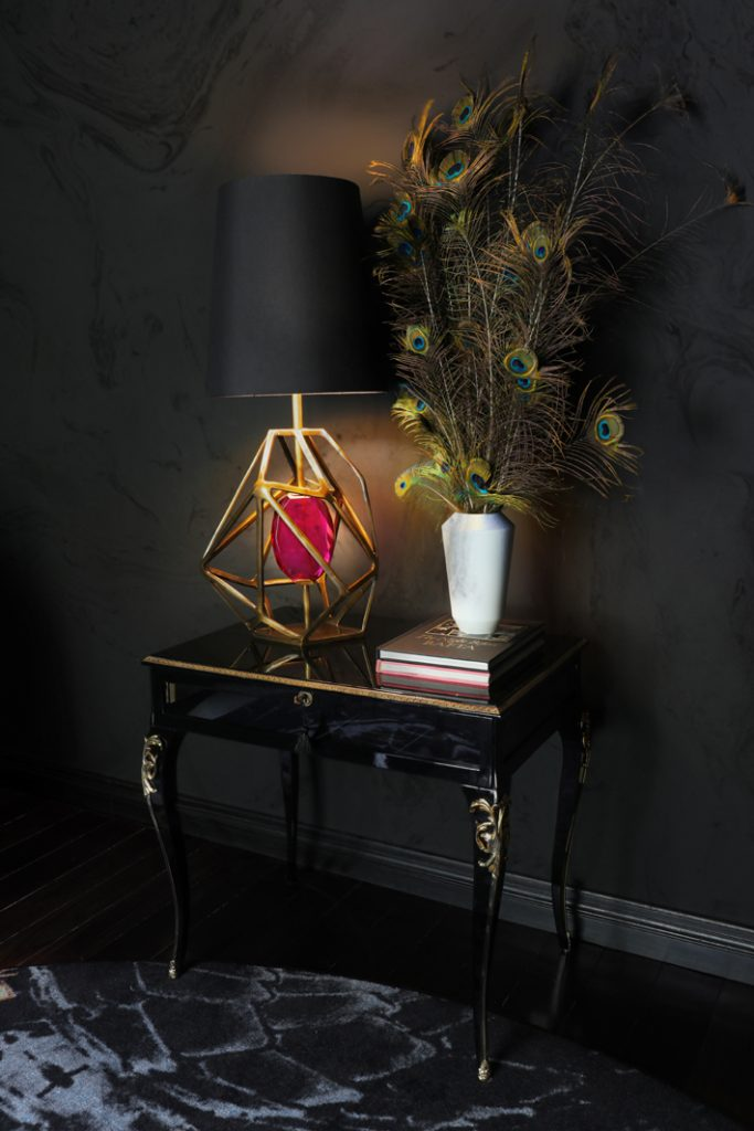 a pink gem table lamp by koket sitting on a cabriole leg black lacquer table - unique shaped lighting