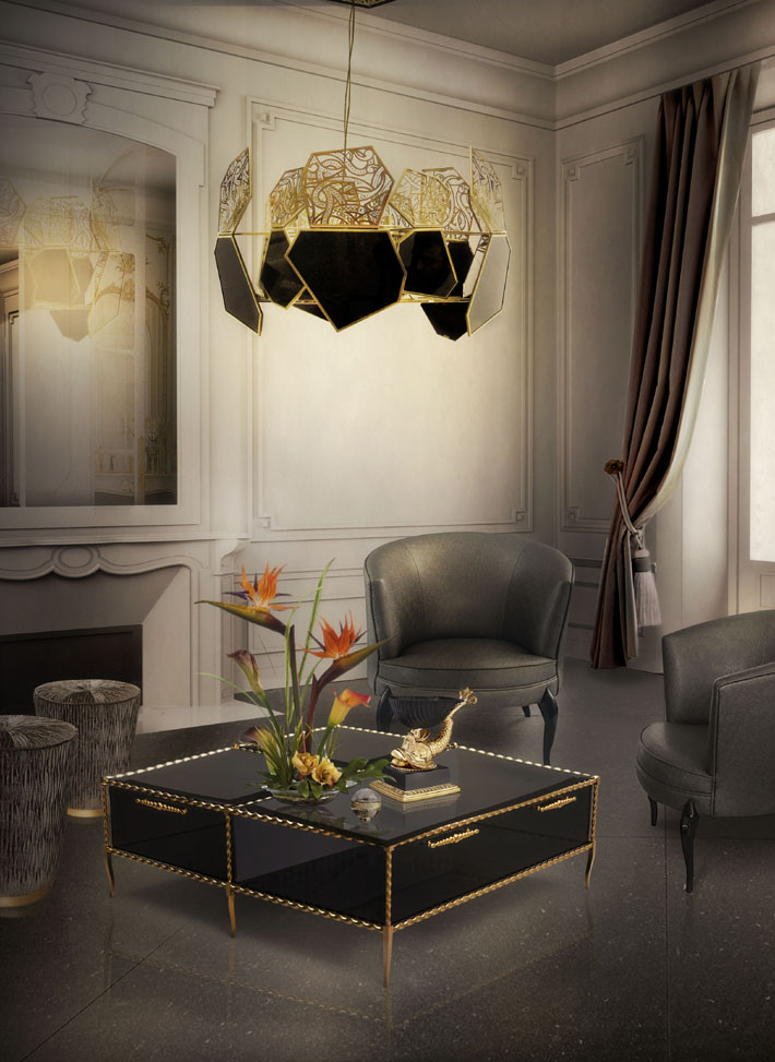 hypnotic chandelier and ivy cocktail table by koket in a gray and brown living room design