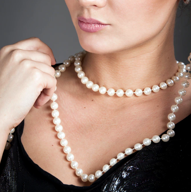 woman wearing pearl necklace - 60s style