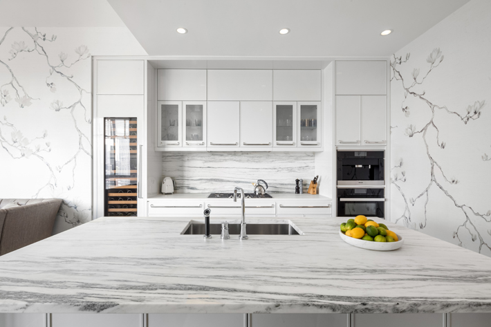 gray and white kitchen at the kent, photo by evan joseph, architecture by beyer blinder belle, interiors by champalimaud design