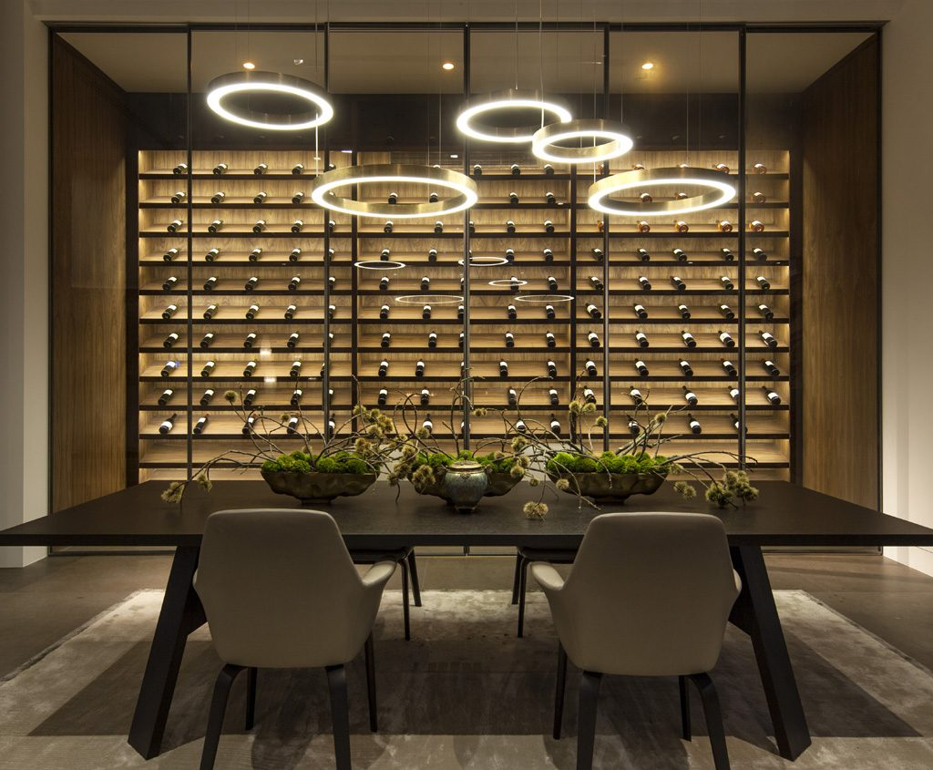 contemporary dining room design with a large wine cellar attached