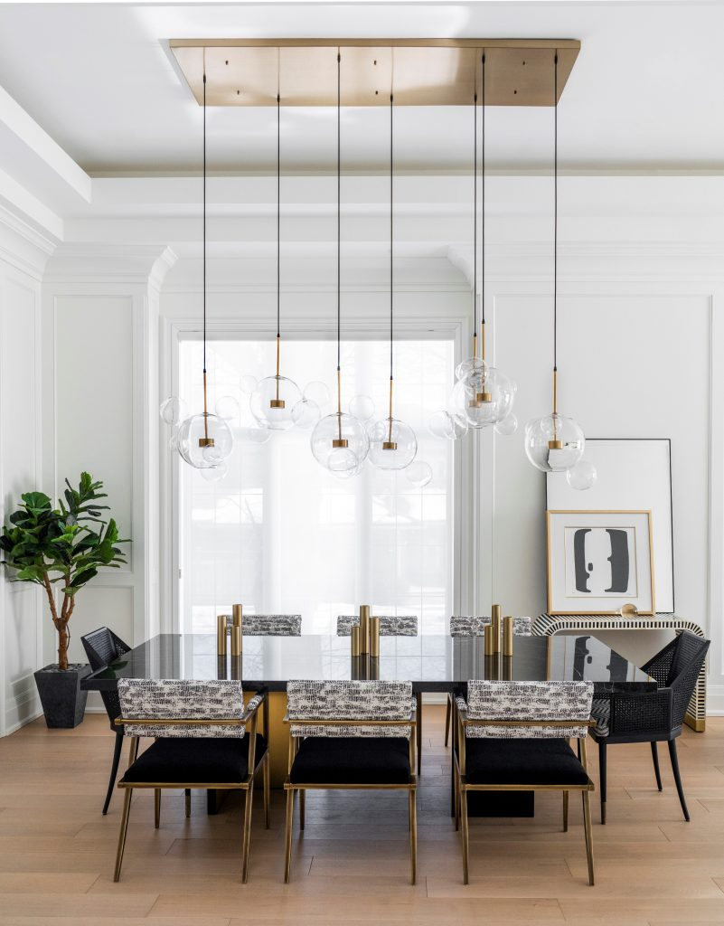 giant chandelier in a modern dining room by jennifer backstein interiors