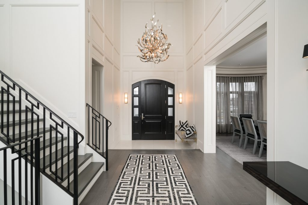 contemporary black and white paneled foyer and stairway by jennifer backstein interiors