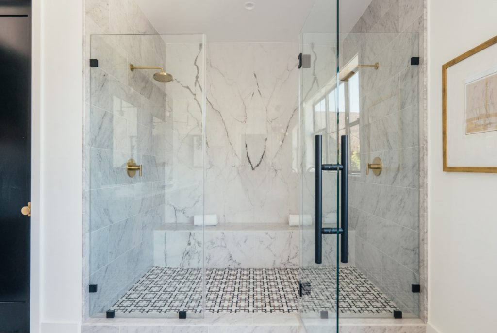 master bathroom shower with white marble