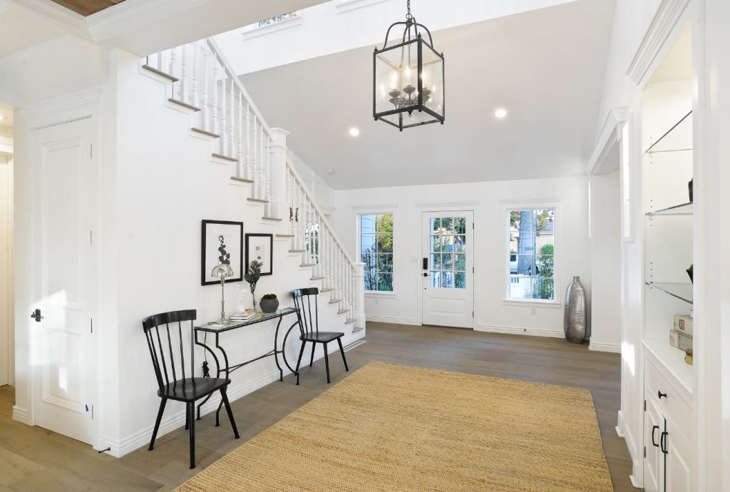 white foyer with natural fiber rug by inhance interiors