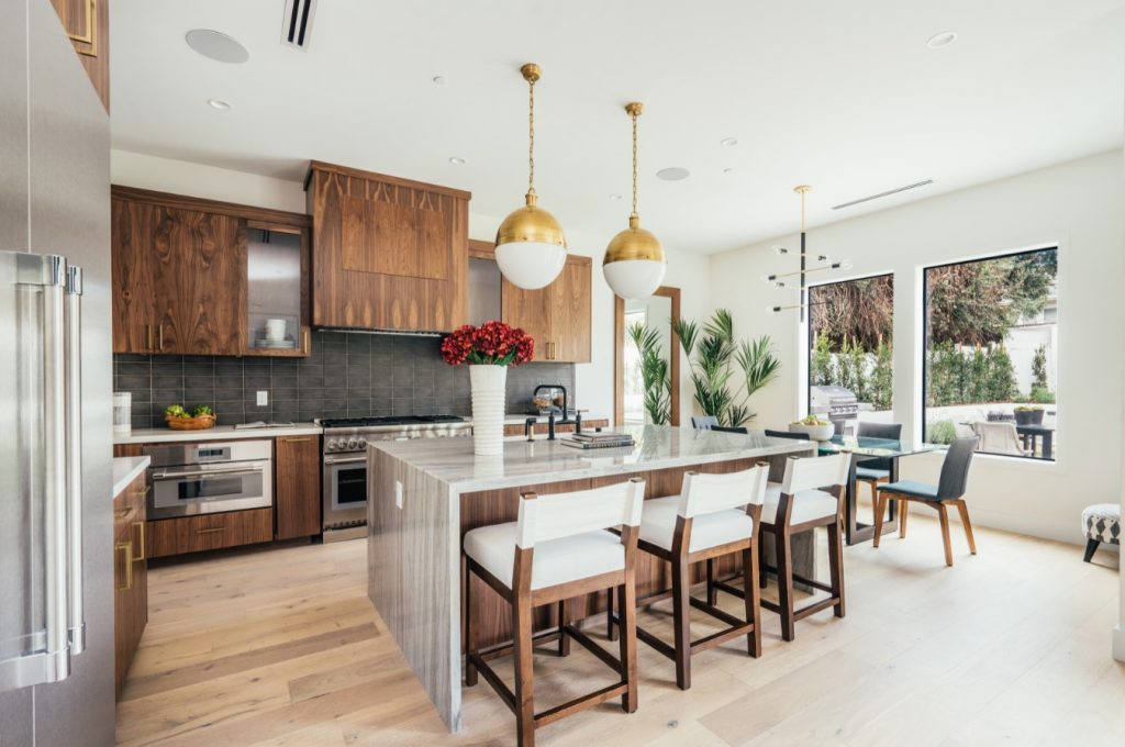 white kitchen with wood cabinets west coast interior design trends