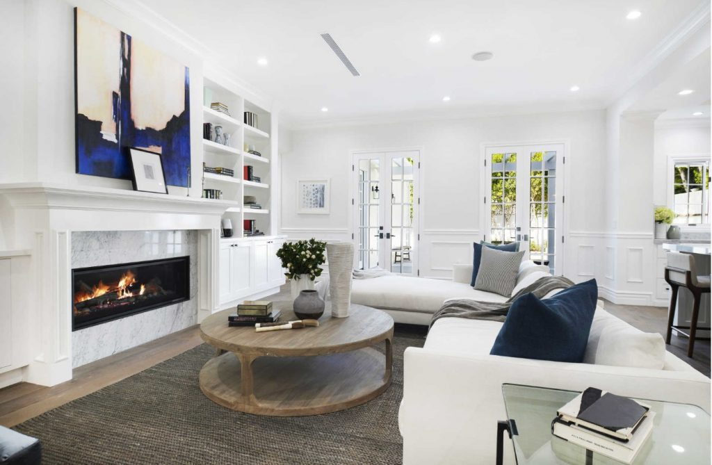 white living room with blue accents by bre hance inhance interiors west coast interior design trends