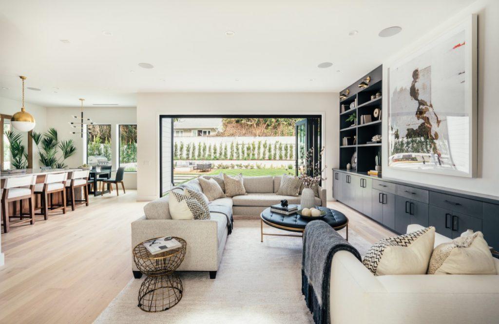 beige living room with indoor/outdoor living by inhance interiors west coast interior design trends