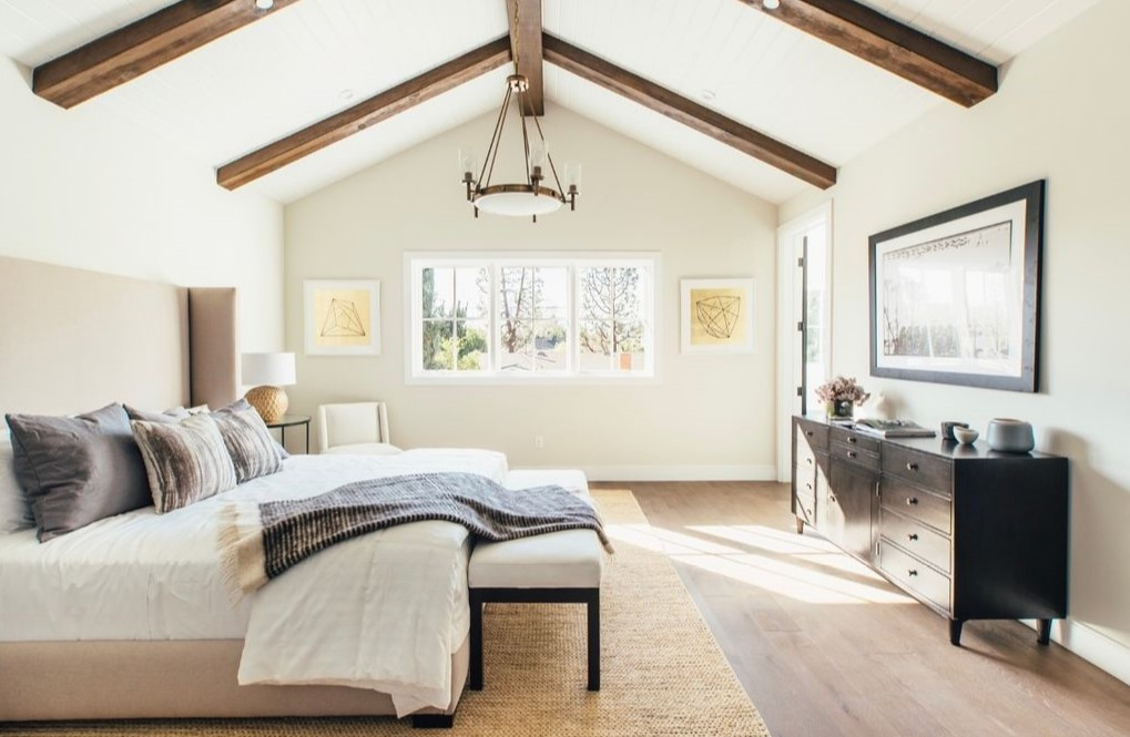 neutral master bedroom with wood beams by inhance interiors west coast interior design trends