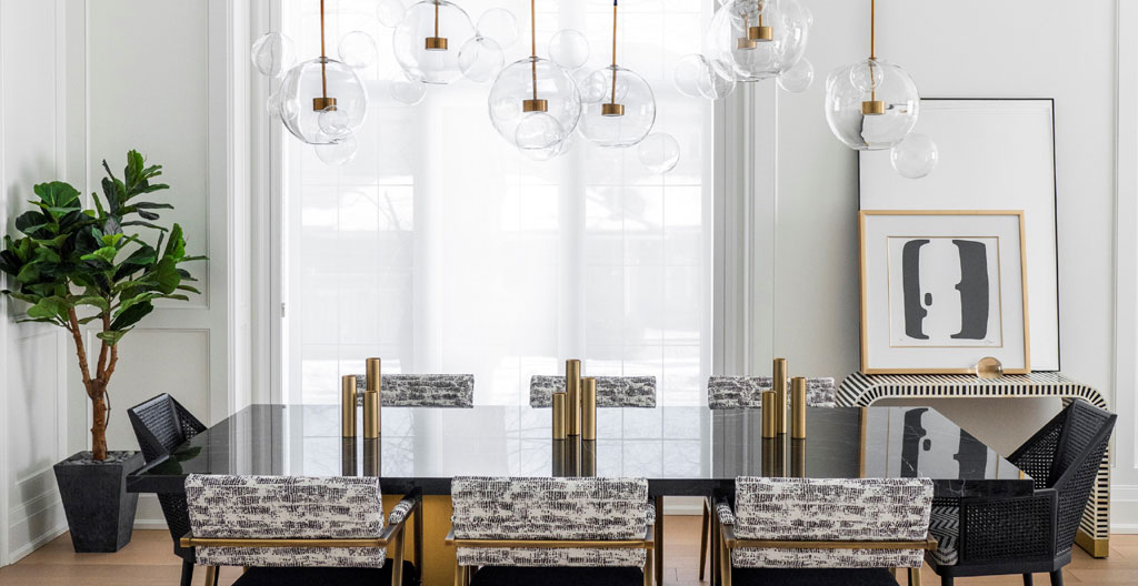 luxurious dining room with giant chandelier by jennifer backstein interiors