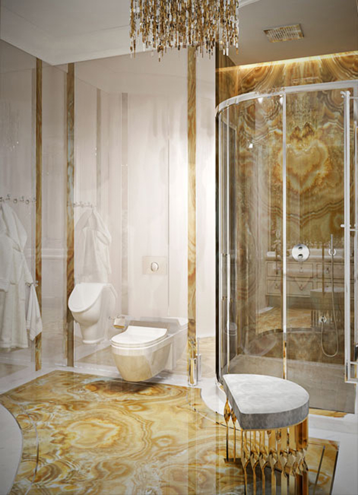 A stunningly timeless bathroom design featuring the brass Mandy stool by KOKET