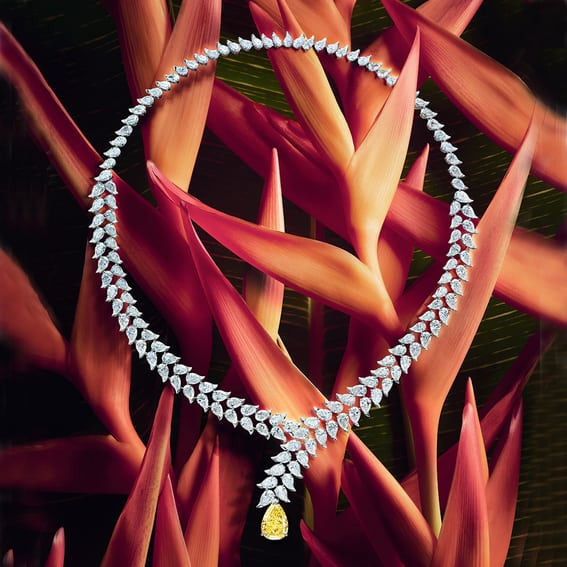 Gracefully adorned by diamonds and a central yellow diamond, the Diamond Heliconia necklace is the shining jewel of this enthralling world.