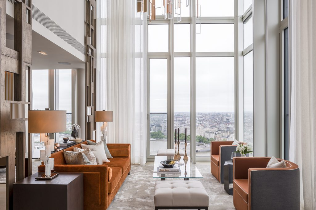 living room featuring burnt orange - 2020 interior design trends - South Bank Tower interior design by Goddard Littlefair