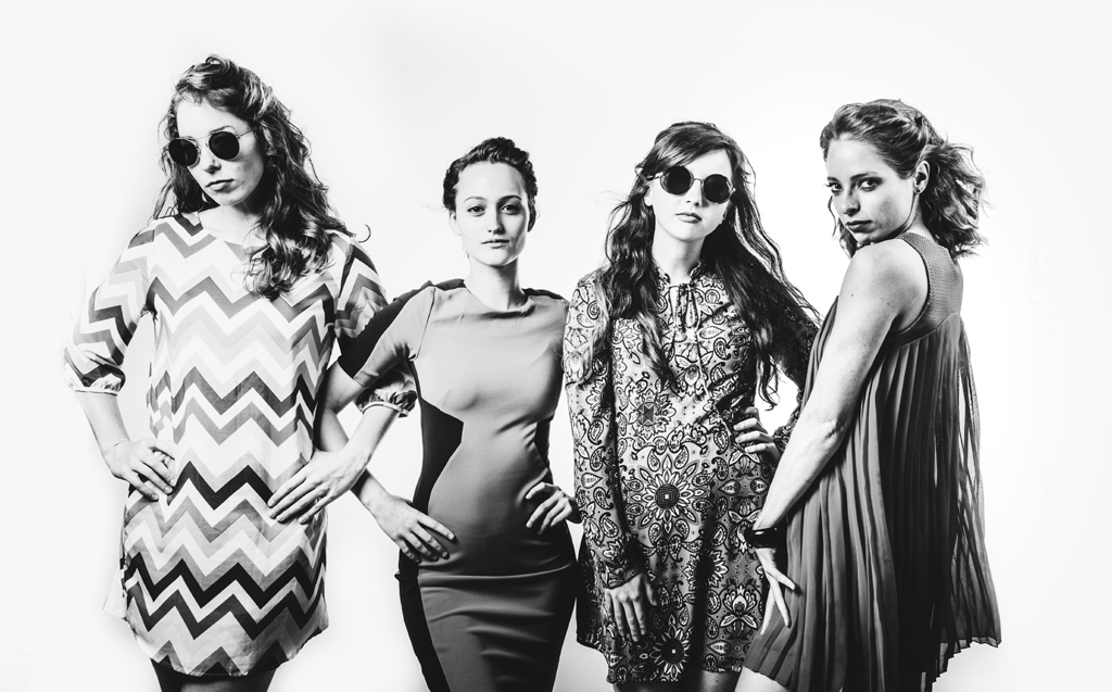black and white photo of four women - female empowerment - susannah burleson unsplash