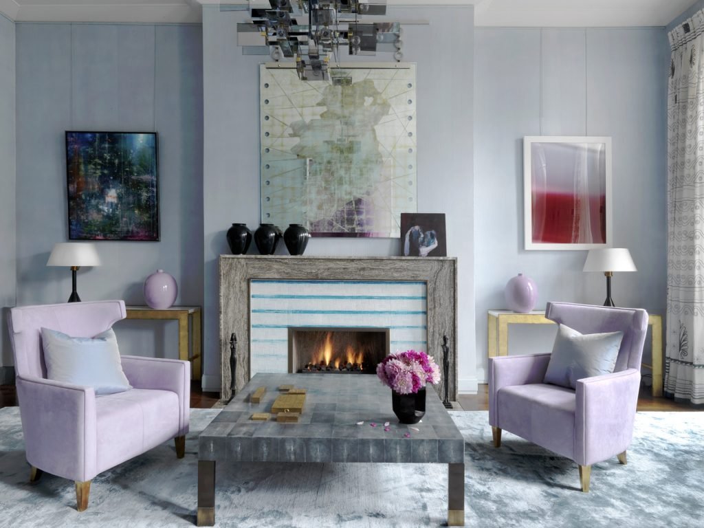 luxurious sitting room in David Collins Home with lavender chairs