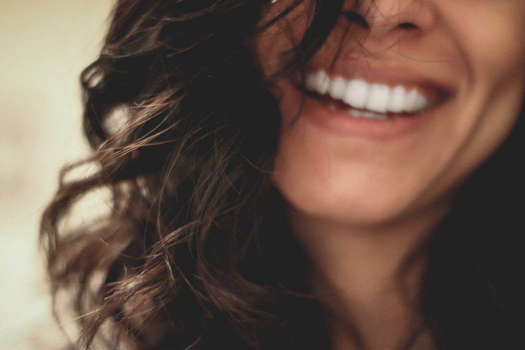 why is a good night sleep important - woman smiling