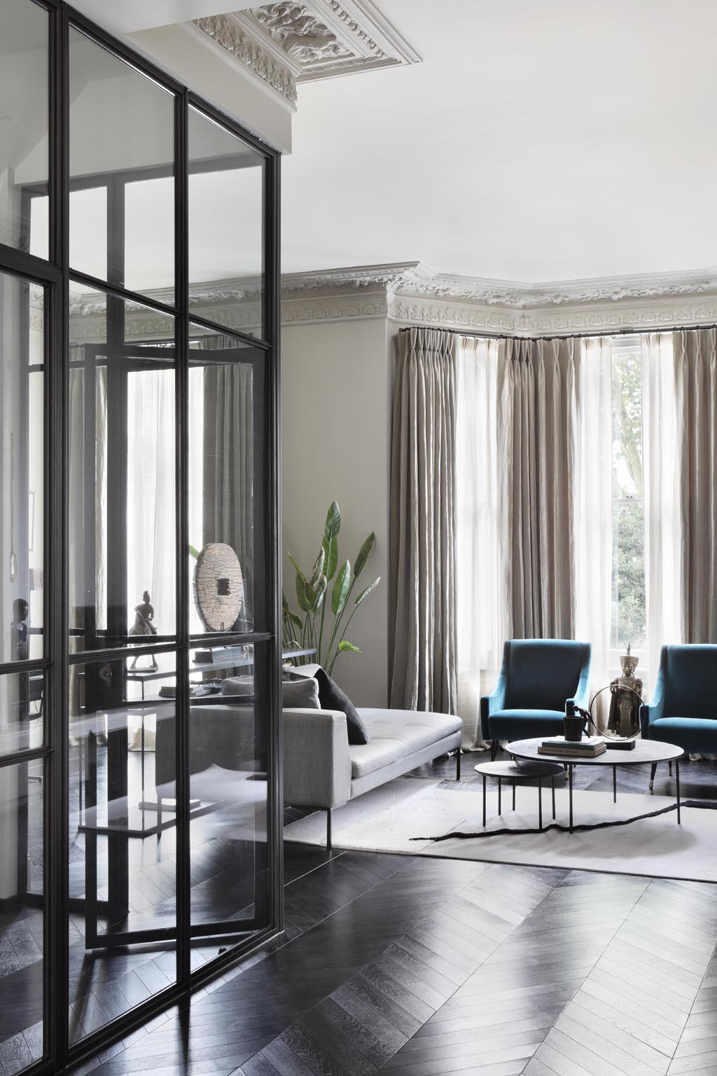 pied a terre living room design with modern glass partition wall and traditional cornices