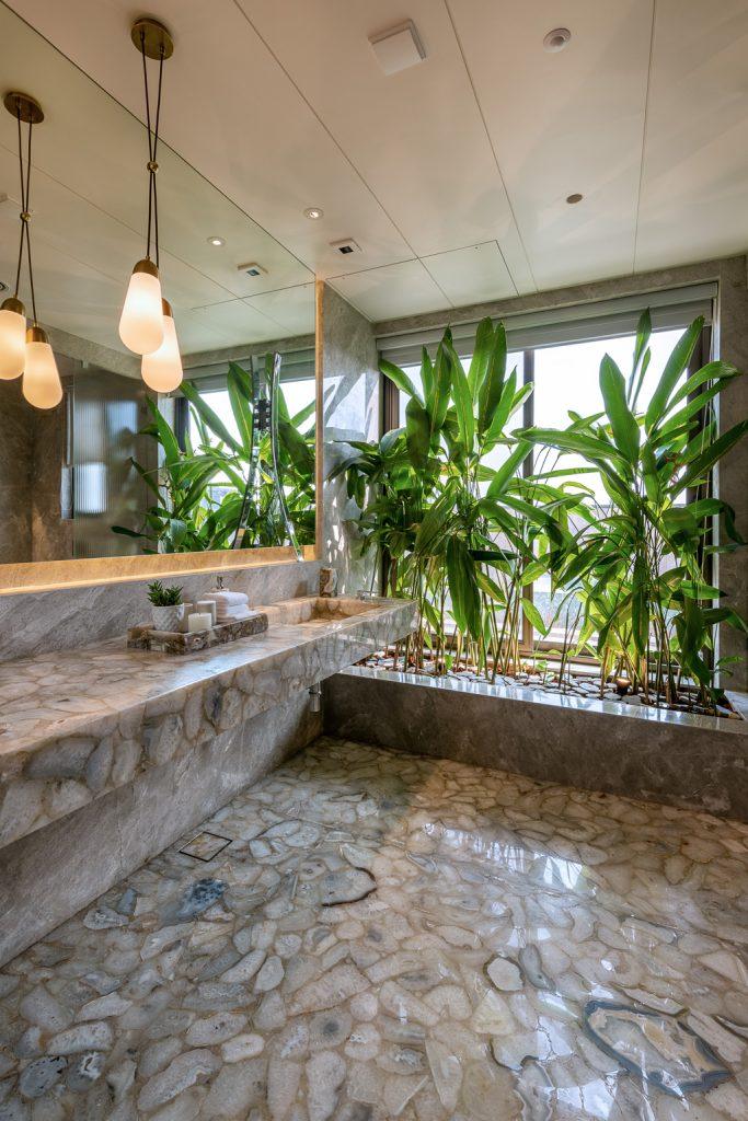 master bathroom with semi-precious stone counter and floor