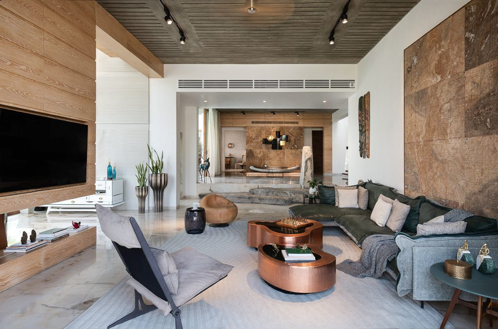 family living room featuring wave cocktail table by koket