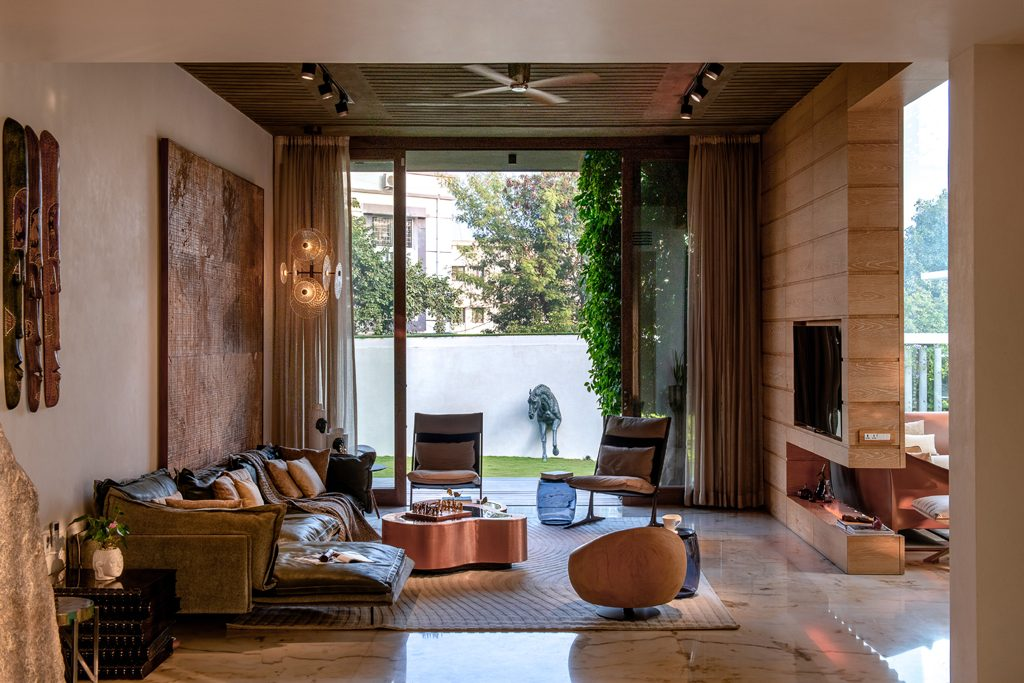 family living room indoor-outdoor living by na architects india