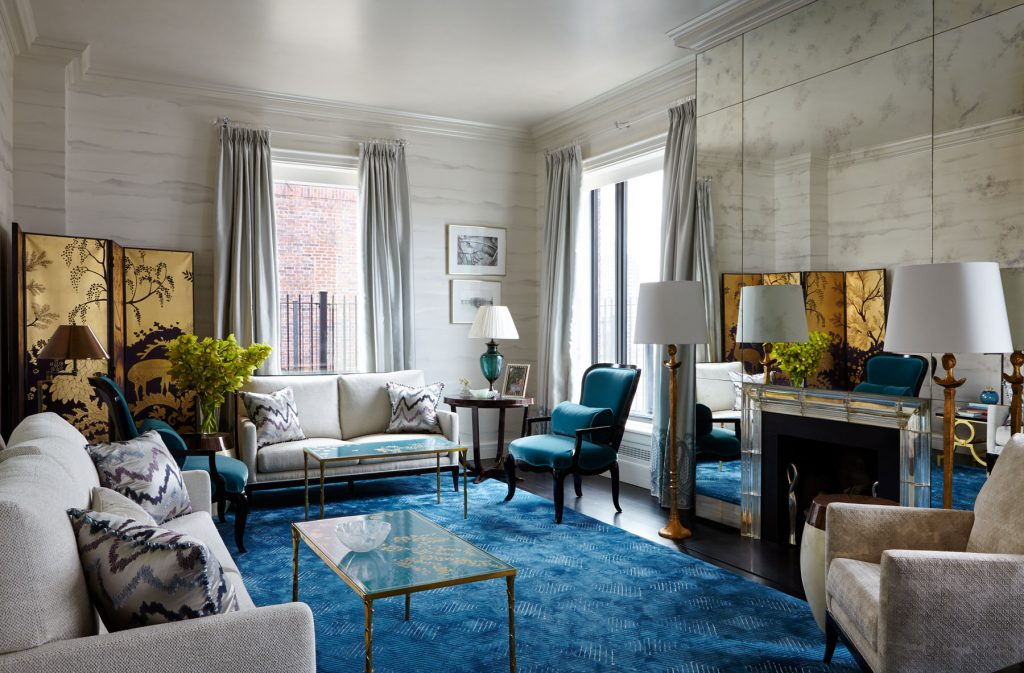 fashionable blue and white living room interior design by nina campbell