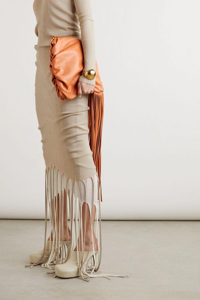Fall 2020 Fashion Trends - BOTTEGA VENETA Open-back layered fringed ribbed-knit turtleneck dress with fringe shoulder bag