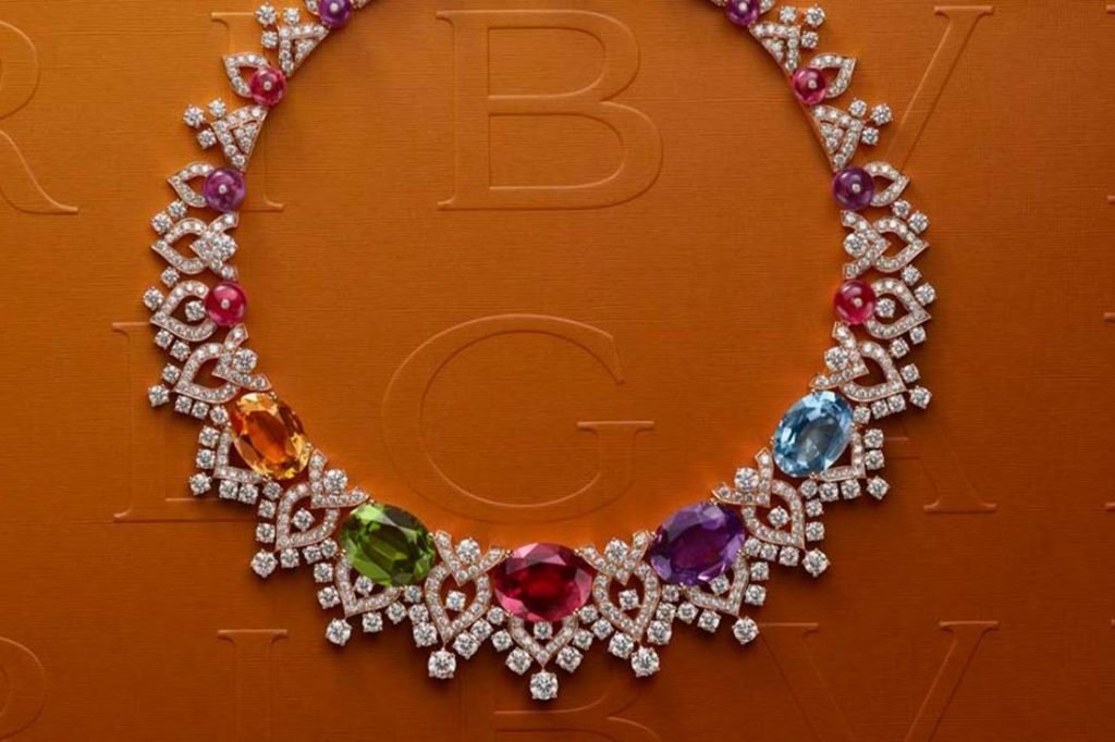 A colorful necklace from Bvlgari's Barocko collection showcasing a rainbow of cabochon-cut gems on a collar of diamonds and stones.