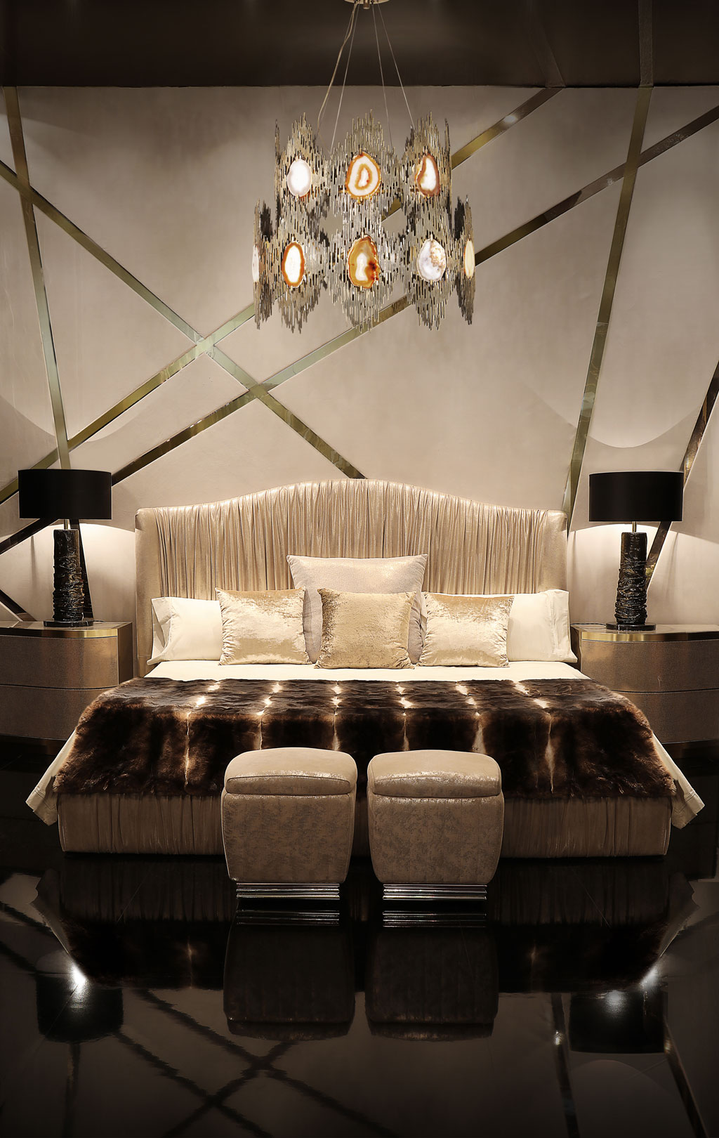 luxurious bedroom with ruched headboard and table lamps by koket and agate chandelier