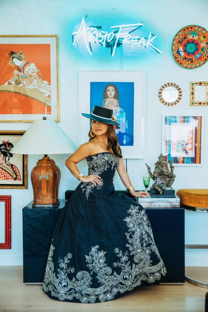 Peti Lau, one of the most stylish women in interior design, wearing an Oscar de la Rental dress in her Los Angeles home. Photo by Nick Onken.