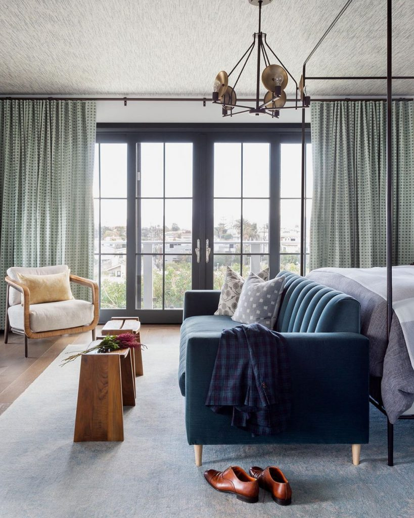 a comfortable masculine bedroom design Photo by Amy Bartlam.