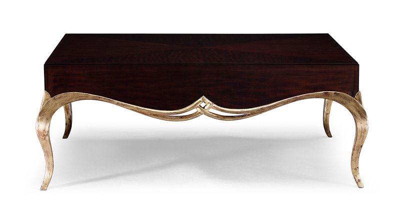 A truly gorgeous coffee table design, with classic Christopher Guy carved detailing, elegantly crafted from solid and veneered mahogany.