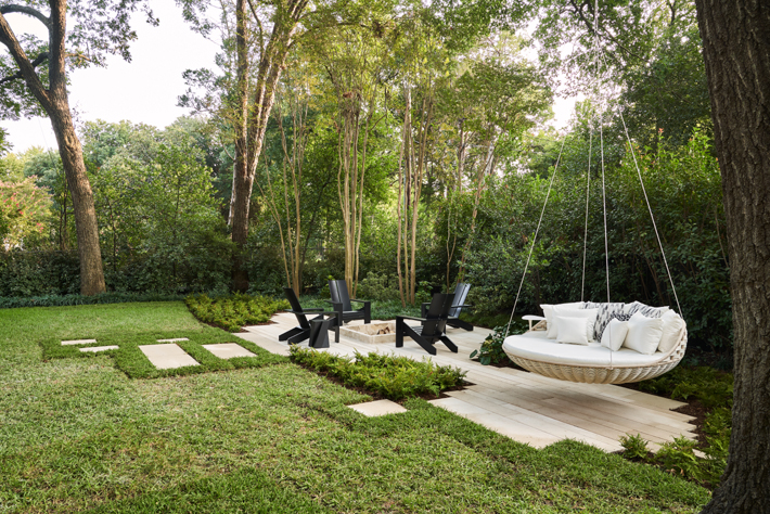 rear landscape with tree swing chair and fire pit by melissa gerstle design