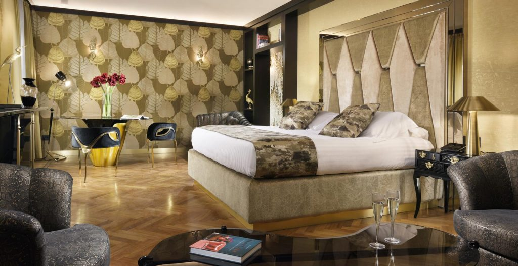 most beautiful hotels Guest room at the Lifestyle Suites Rome featuring KOKET's Chandra dining chair, Yasmin dining table (Back), and Besame Chairs (Front)
