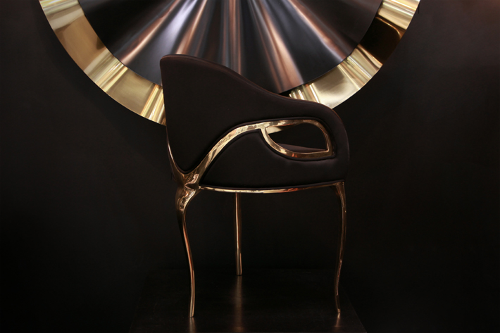 Two of KOKET's most popular designs, the Reve Mirror and Chandra Chair