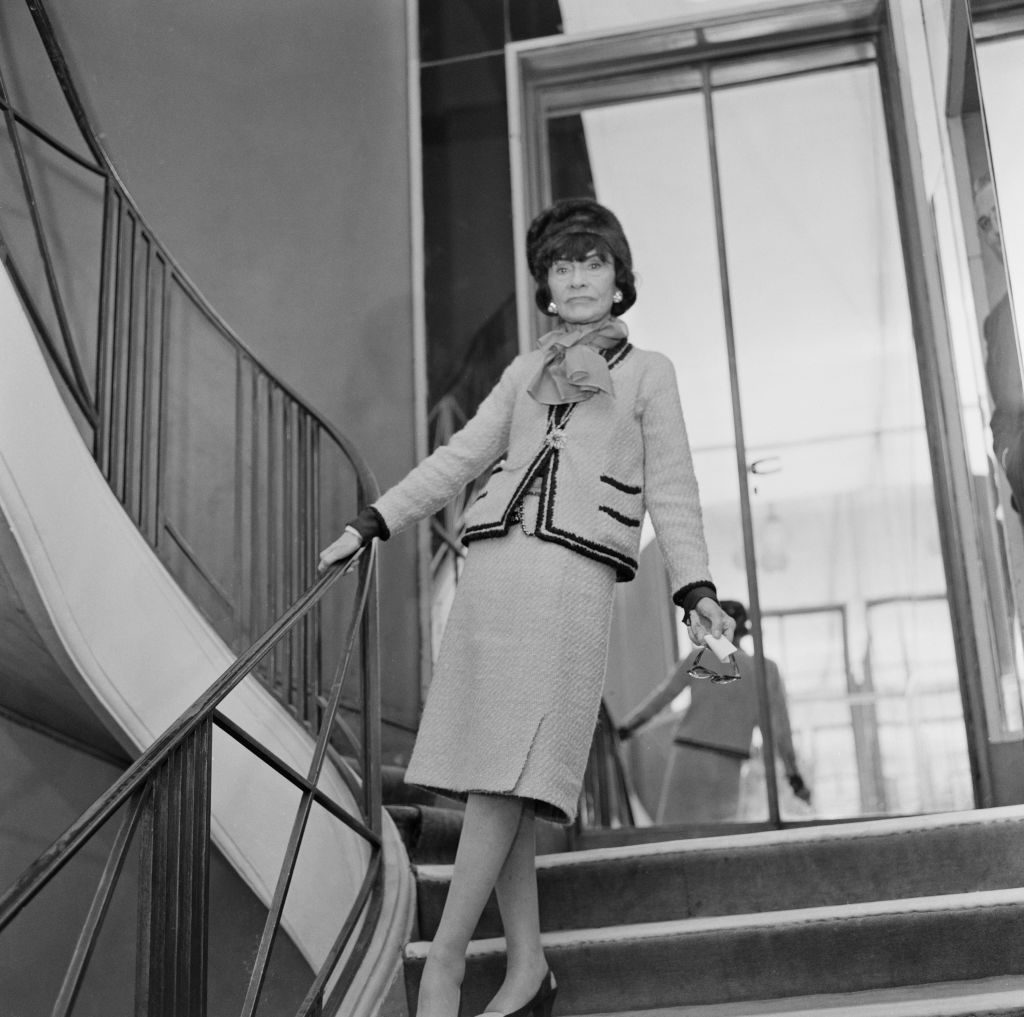 French fashion designer and a businesswoman Coco Chanel (1883 - 1971) in Paris, France, wearing one of her iconic tweed suits, 29th January 1963. (Photo by Michael Hardy/Daily Express/Hulton Archive/Getty Images)