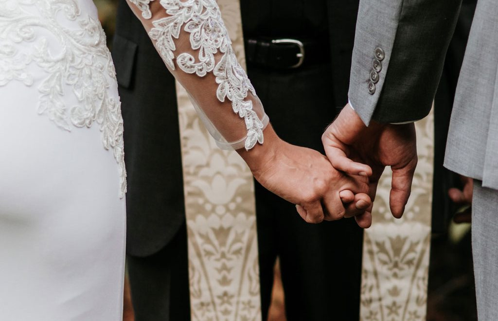 habits of the happiest couples - bride and groom holding hands -happy marriages