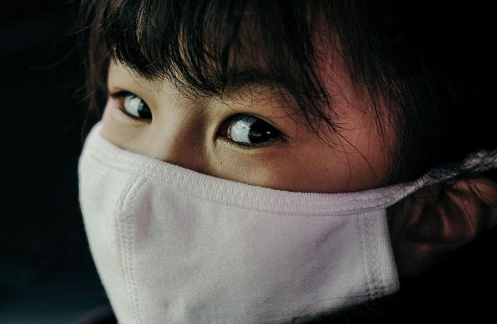 encouraging children to wear face masks covid-19 little girl wearing face mask insung yoon unsplash