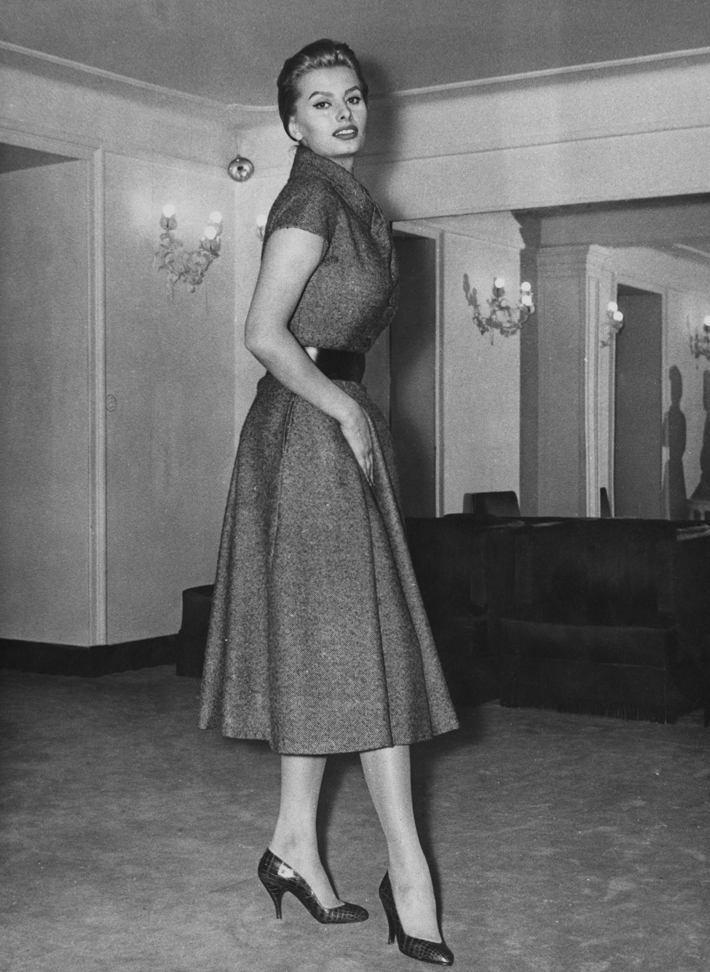 history of fashion - Italian actress Sophia Loren tries on a Christian Dior 'New Line' dress made by Battilocchi of Rome, in a store in Rome, Italy, 6th February 1956. (Photo by Keystone/Hulton Archive/Getty Images)