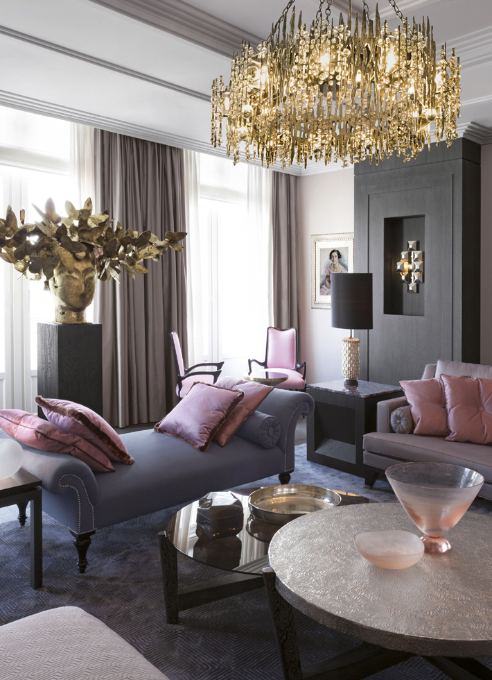 pink and gray living room interior design with gold lighting
