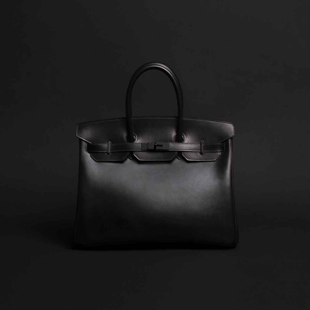 worth-it luxury buys for the modern working woman - birkin bag in black by hermes