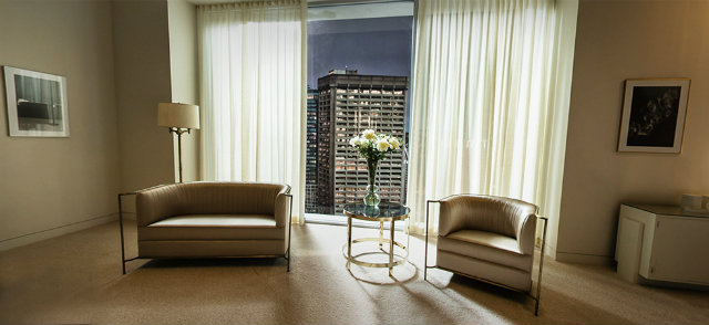 Christian Grey's Apartment featuring the Desire Sofa and Chair by KOKET