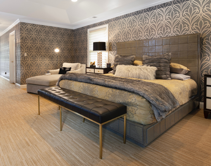 glamorous master bedroom deign fur pillows and blanket gold and taupe
