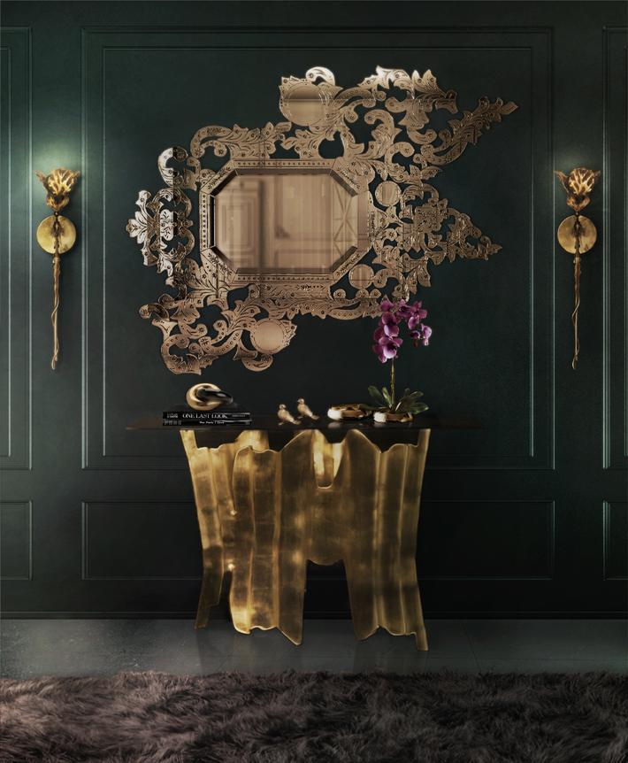 Dramatic hallway design by KOKET addicata venetian mirror, floral sconces and gold console table