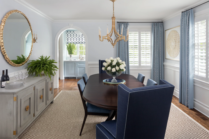 investment pieces of furniture in blue brown and cream dining room Interior by Hackett Interiors