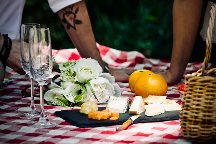 Champagne, charcuterie board, and cheese pairings picnic