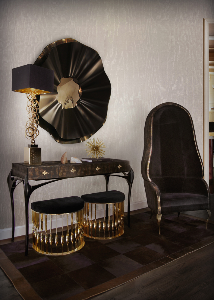 Dramatic hallway by KOKET mandy stools reve mirror drapesse chair