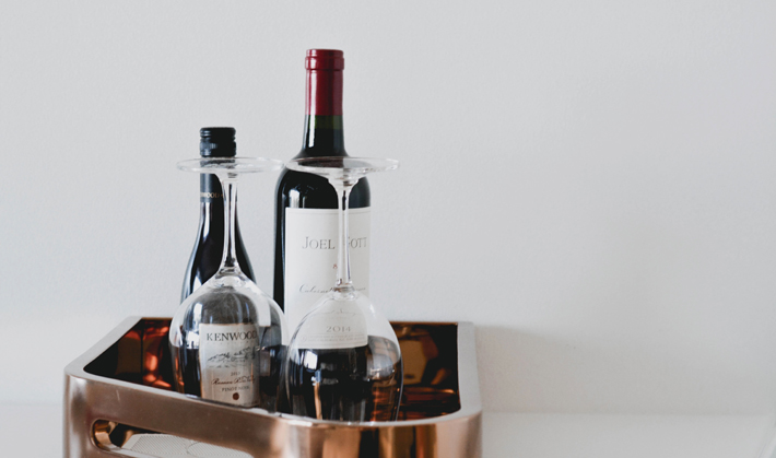 become a wine connoisseur with these tips - red wine glasses and bottles on a tray