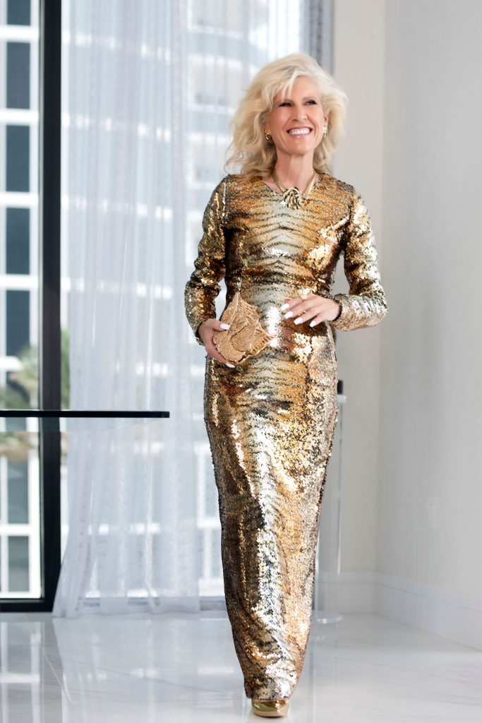 Donna Leah in one of her metallic gold evening gown designs