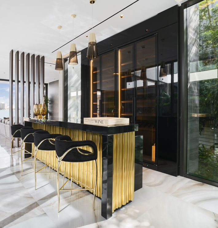 luxurious home bar design ideas Kitchen by Mendez Vela Design featuring Chandra Barstools by KOKET