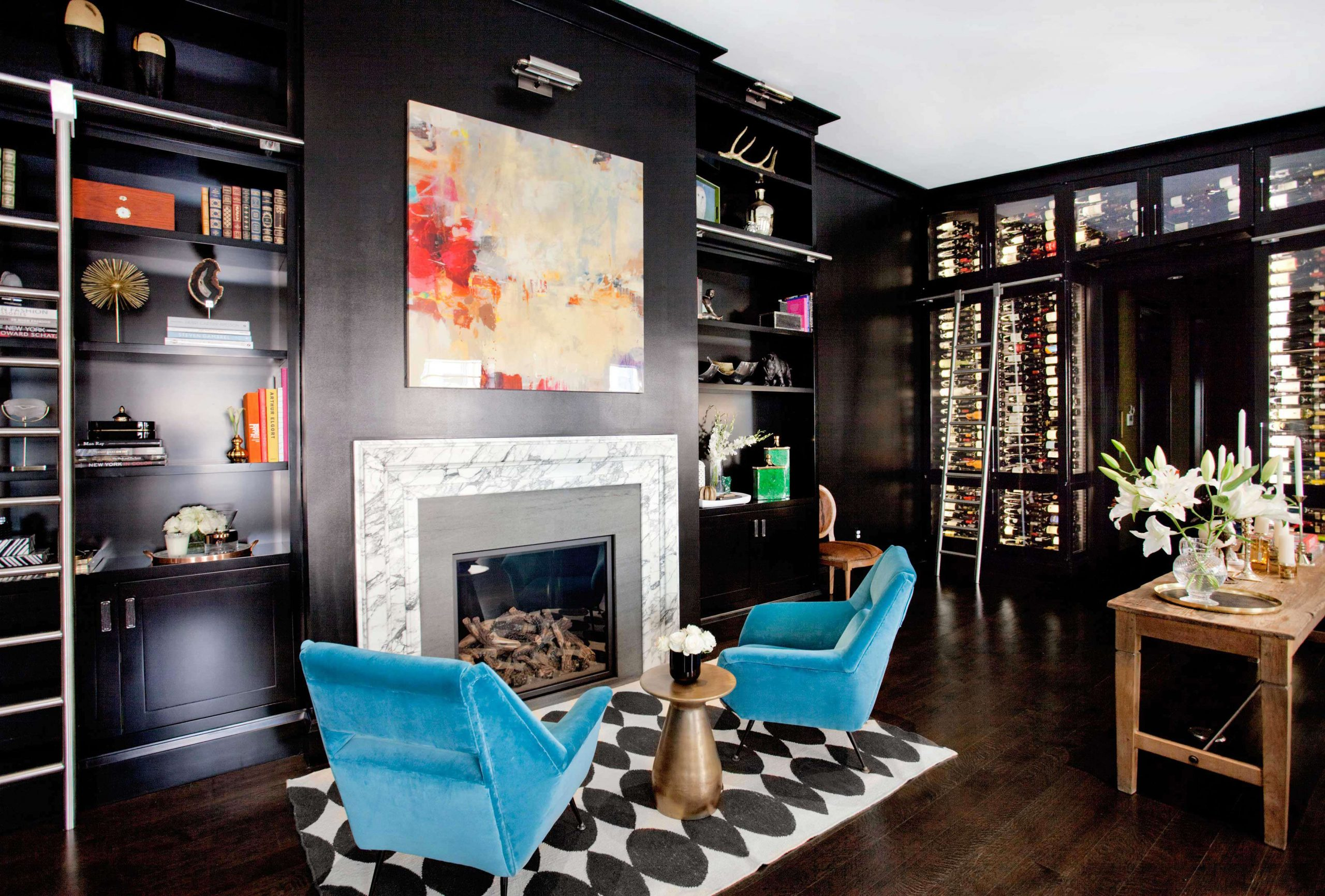 A stunning East Village New York Apartment library that doubles as a wine cellar by Nicole Fuller Interiors
